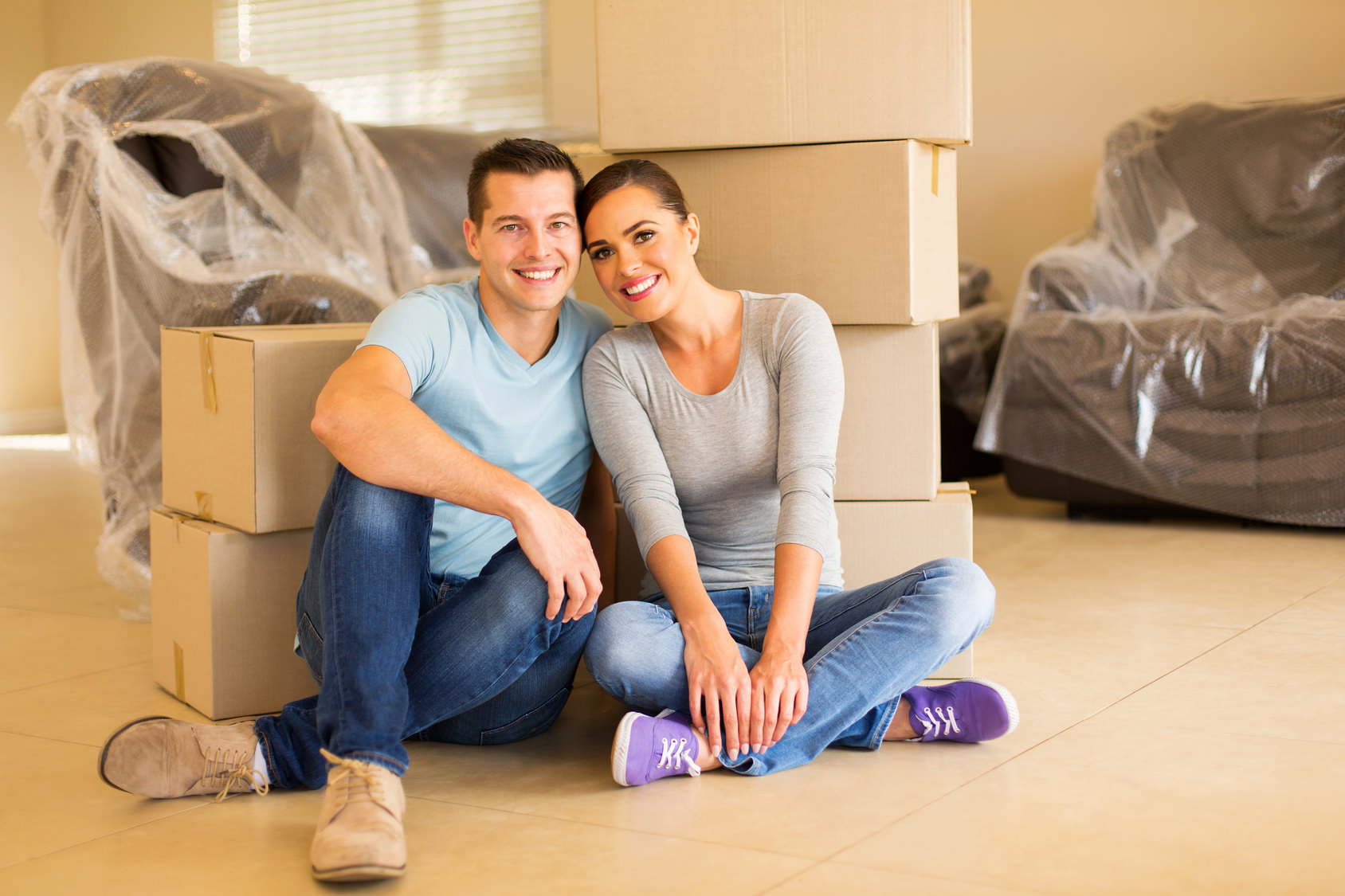 couple sitting in new house