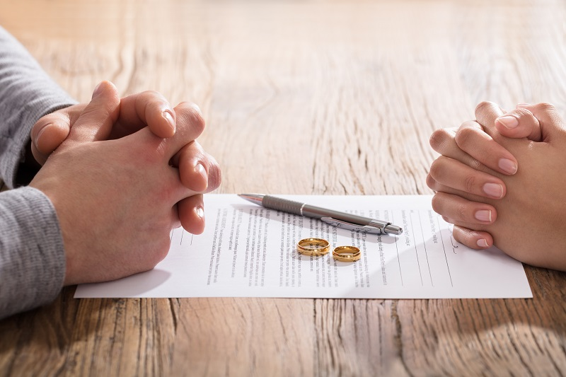 Couple's Hand On Divorce Agreement